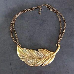 Large gold tone boho feather necklace